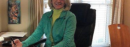 Gwen at desk